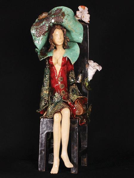 Beautiiful seated ceramic girl